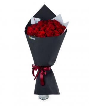 Bouquet `Douglas` with red roses 25 pcs