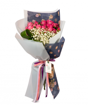 Bouquet `Almiros` with peony roses and gypsophilia