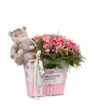 Composition `Enns` with soft toys and flowers