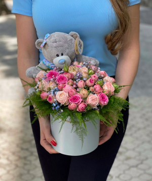 Composition `Cranidion` with spray roses and gypsophila